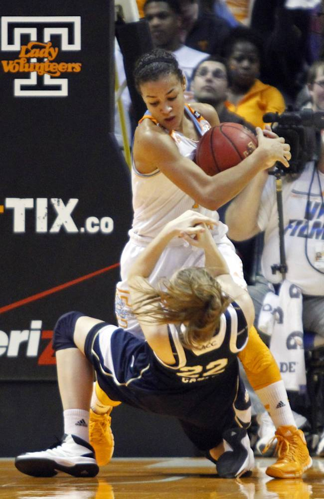 Tennessee guard Andraya Carter (14) grabs the ball away Notre Dame guard Madison Cable (22) as she falls to the floor in the second half of an NCAA college basketball game Monday, Jan. 20, 2014, in Knoxville, Tenn. Notre Dame won 86-70