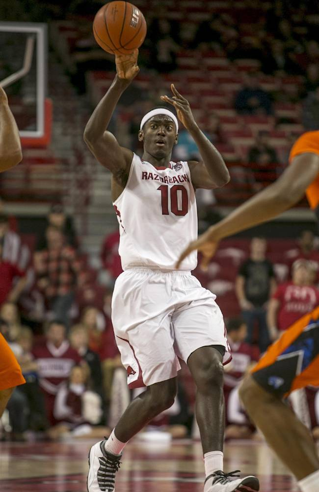 Arkansas forward Bobby Portis, 10, lobs the ball down the court during the second half of a NCAA college basketball game against Savannah State Thursday, Dec. 12, 2013 at Bud Walton Arena in Fayetteville, Ark. Arkansas defeated Savannah State 72-43