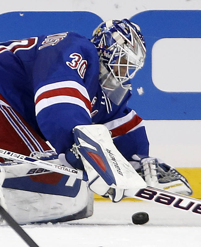 New York Rangers goalie Henrik Lundqvist (30) of Sweden makes a save in the second period of their NHL hockey game against the Washington Capitals at Madison Square Garden in New York, Sunday, Jan. 19, 2014