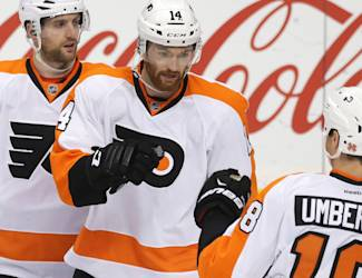 Teammates celebrate a goal by Philadelphia Flyers' Sean Couturier, center, off Minnesota Wild goalie Darcy Kuemper in the first period of an NHL hockey game, Tuesday, Dec. 23, 2014, in St. Paul, Minn. (AP Photo/Jim Mone)