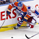 New York Rangers Anton Stralman (6) and Edmonton Oilers Matt Hendricks (23) battle for the puck during second period NHL hockey action in Edmonton, Alberta, on Sunday March 30, 2014 The Associated Press