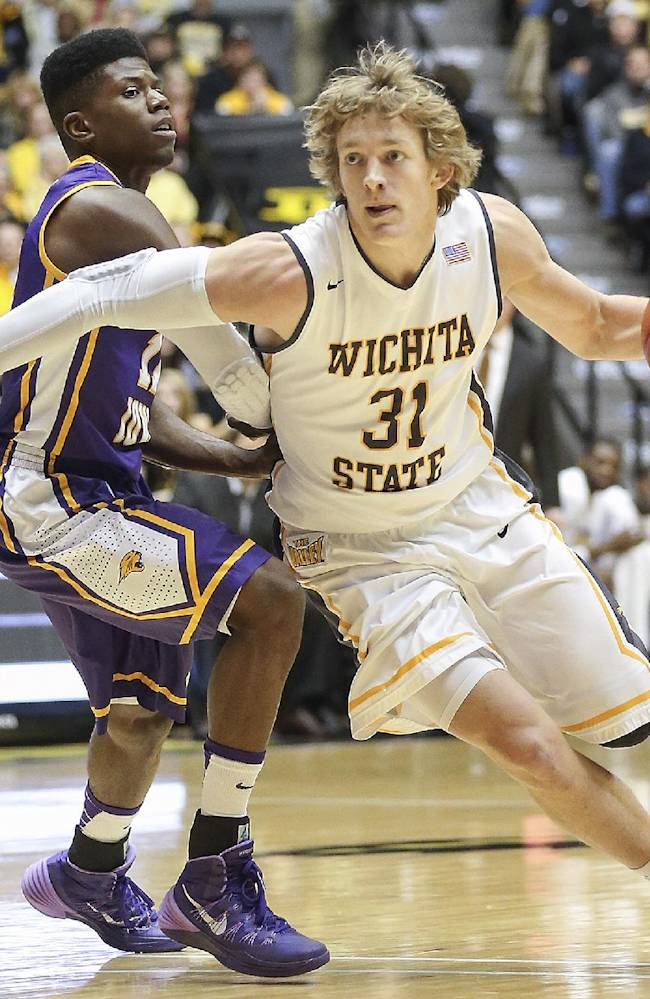 Wichita State's Ron Baker drives against Northern Iowa's Wes Washpun in the first half of an NCAA college basketball game in Wichita, Kan., Sunday, Jan. 5, 2014