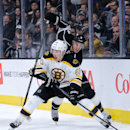 Boston Bruins' Brad Marchand, front, moves the puck as he is defended by Los Angeles Kings' Brayden McNabb during the third period of an NHL hockey game Tuesday, Dec. 2, 2014, in Los Angeles. The Kings won 2-0 The Associated Press