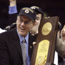 ADVANCE FOR WEEKEND EDITIONS, NOV. 1-2 - FILE - In this April 7, 2003, file photo, Syracuse head coach Jim Boeheim accepts the national championship trophy after the Orangemen beat Kansas 81-78 at the Final Four in New Orleans. The Atlantic Coast Conference had an impressive enough roster of Naismith Hall of Fame coaches before expansion with Duke's Mike Krzyzewski and North Carolina's Roy Williams. Then it added Syracuse's Jim Boeheim last year, and now is bringing in Louisville's Rick Pitino. It's a group with nine NCAA championships combined and now they're going to be fighting each other for an ACC title. (AP Photo/Michael Conroy, File)