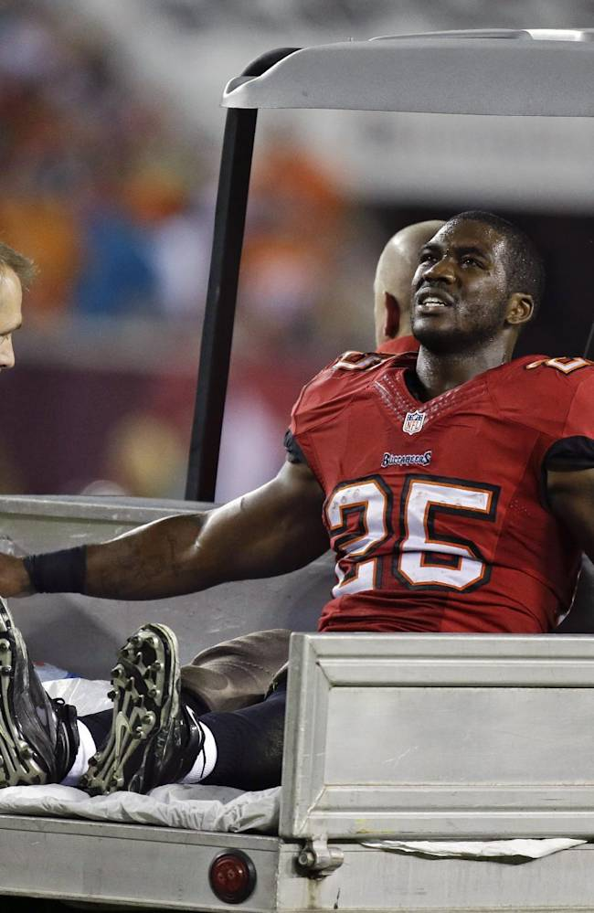 Tampa Bay Buccaneers running back Mike James leaves the field after he was injured during the first half of an NFL football game against the Miami Dolphins in Tampa, Fla., Monday, Nov. 11, 2013