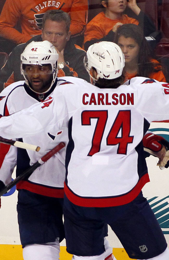 Washington Capitals' Joel Ward, left is congratulated by John Carlson after Ward scored in the second period of an NHL hockey game with the Philadelphia Flyers, Friday, Nov. 1, 2013, in Philadelphia