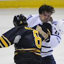 Buffalo Sabres center Cody McCormick (8) knocks the helmet off Toronto Maple Leafs center David Clarkson (71)during a third period fight in an NHL hockey preseason game, Friday, Sept. 26, 2014, in Buffalo, N.Y. Toronto won 6-4. The Associated Press