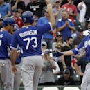 Los Angeles Dodgers' Scott Van Slyke, right, is congratulated by Clint Robinson and A.J. Ellis after hitting a grand slam during the sixth inning of an exhibition spring training baseball game against the Los Angeles Angels Thursday, March 6, 2014, in Te
