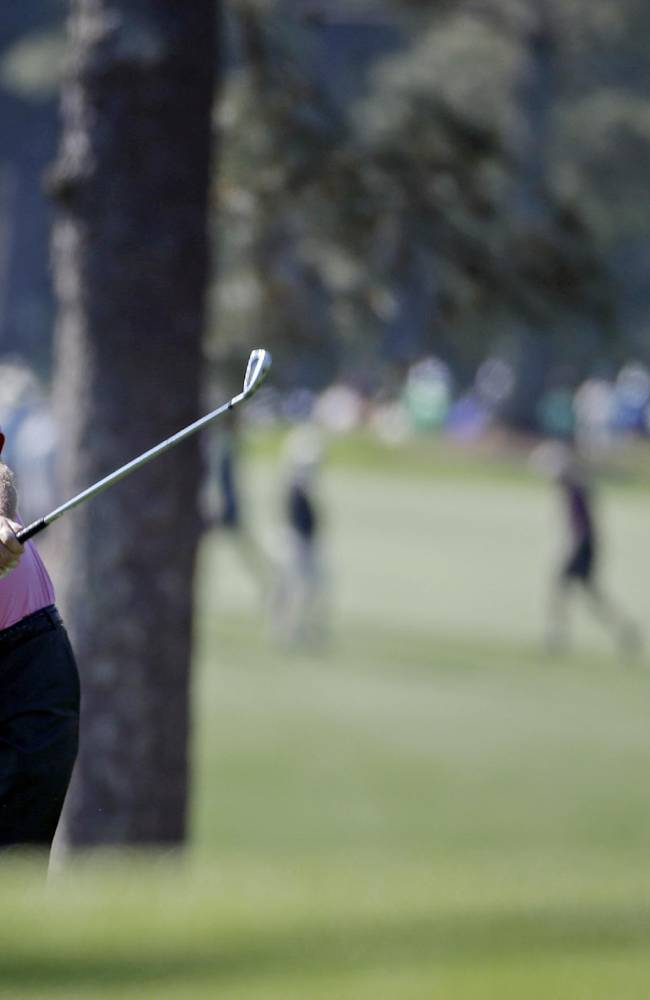 Miguel Angel Jimenez, of Spain, hits off the first fairway during the first round of the Masters golf tournament Thursday, April 10, 2014, in Augusta, Ga