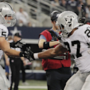 Oakland Raiders running back Rashad Jennings (27) celebrates his touchdown against the Dallas Cowboys with Jeron Mastrud (85) during the first half of an NFL football game, Thursday, Nov. 28, 2013, in Arlington, Texas The Associated Press