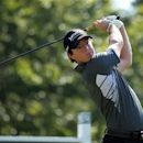 Rory McIlroy, from Northern Ireland, hits his tee shot on the 16th hole during the second round of the Deutsche Bank Championship PGA golf tournament at TPC Boston in Norton, Mass., Saturday, Sept. 1, 2012. (AP Photo/Stew Milne)