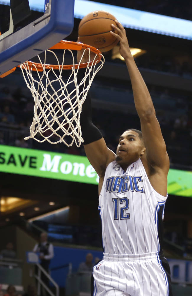 Orlando Magic small forward Tobias Harris (12) stuffs the ball during the second half of an NBA basketball game against the Detroit Pistons on Sunday,  Oct. 20, 2013, in Orlando, Fla..The Magic won 86-87