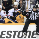 Nashville Predators left wing James Neal (18) and linesman Don Henderson (91) end up in the Chicago Blackhawks bench in the first period of an NHL hockey game Saturday, Dec. 6, 2014, in Nashville, Tenn The Associated Press