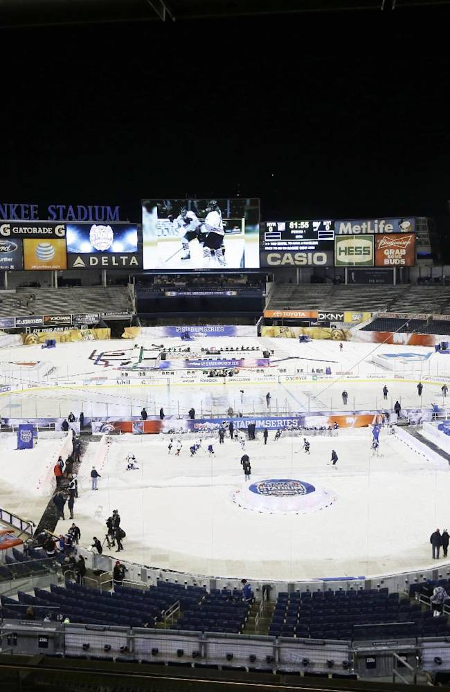 Preperations are made before an outdoor NHL hockey game between the New York Islanders and the New York Rangers Wednesday, Jan. 29, 2014, at Yankee Stadium in New York