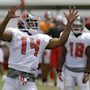 Tampa Bay Buccaneers wide receiver Robert Herron (14) can't hang onto a pass from quarterback Josh McCown during an NFL football training camp Sunday, Aug. 10, 2014, in Tampa, Fla The Associated Press