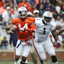 Auburn quarterback Nick Marshall (14) runs as Auburn defensive tackle Montravius Adams (1) gives chase in the first half of the annual A Day spring intrasquad college football game, Saturday, April 19, 2014, in Auburn, Ala The Associated Press