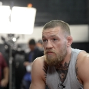 TORRENCE, CA - FEBRUARY 24:  UFC featherweight champion Conor McGregor speaks during an interview after a news conference with lightweight contender Nate Diaz at UFC Gym February 24, 2016, in Torrance, California. (Photo by Kevork Djansezian/Getty Images)