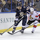 Ottawa Senators' Mark Stone (61) tries to poke the puck away from St. Louis Blues' Kevin Shattenkirk (22) in the first period of a NHL hockey game, Tuesday, Nov. 25, 2014 in St. Louis The Associated Press