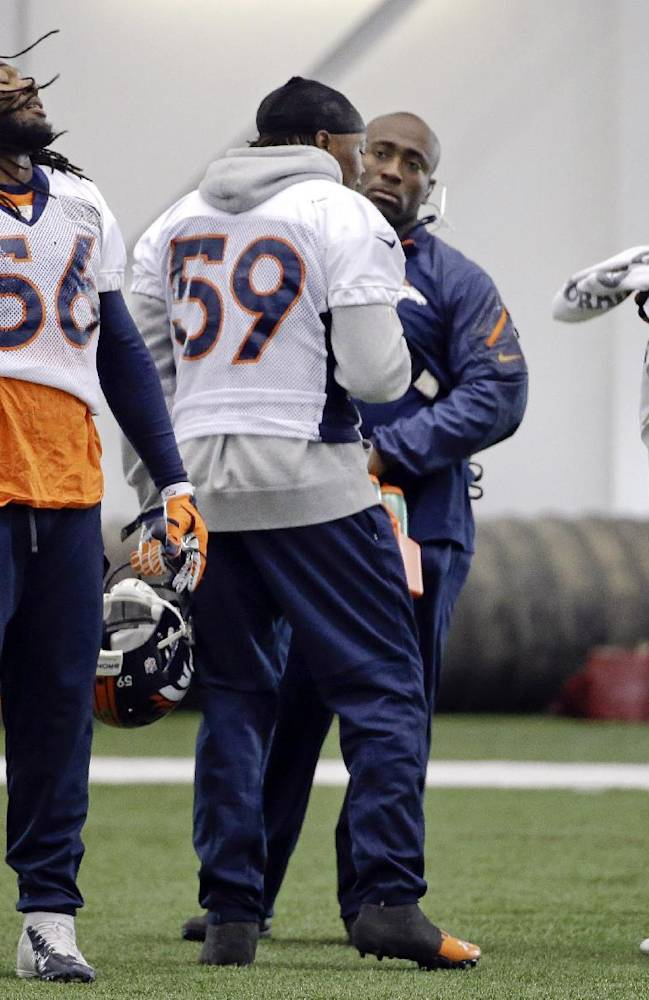 Denver Broncos linebackers Nate Irving (56), Danny Trevathan (59) and Wesley Woodyard, right, take a break between drills during practice Thursday, Jan. 30, 2014, in Florham Park, N.J. The Broncos are scheduled to play the Seattle Seahawks in the NFL Super Bowl XLVIII football game Sunday, Feb. 2, in East Rutherford, N.J. (AP Photo)