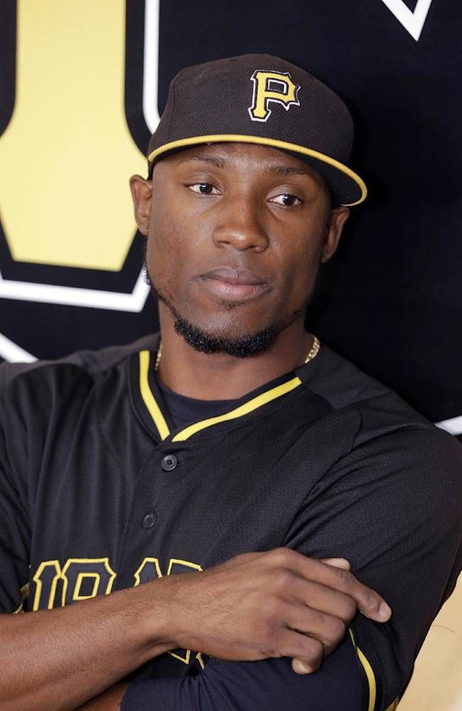 Pittsburgh Pirates left fielder Starling Marte is seen during during a news conference where his contract extension was discussed before a spring exhibition baseball game against the New York Yankees in Bradenton, Fla., Thursday, March 27, 2014