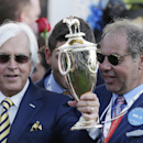 FILE- In this May 2, 2015, file photo, trainer Bob Baffert, left, holds up the winning trophy alongside Ahmed Zayat, owner of American Pharoah, after American Pharoah won the 141st running of the Kentucky Derby horse race at Churchill Downs in Louisville, Ky. Baffert says