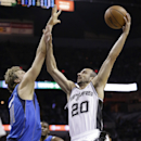 San Antonio Spurs' Manu Ginobili (20), of Argentina shoots over Dallas Mavericks' Dirk Nowitzki (41), of Germany, during the first quarter of Game 1 of the opening-round NBA basketball playoff series on Sunday, April 20, 2014, in San Antonio. (AP Photo/Eric Gay)