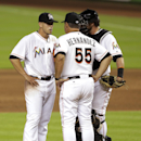 Miami Marlins starting pitcher Jose Fernandez, left, talks with pitching coach Chuck Hernandez (55) and catcher Jarrod Saltalamacchia, right, during the sixth inning of a baseball game against the Washington Nationals, Wednesday, April 16, 2014, in Miami