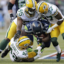 Seattle Seahawks running back Marshawn Lynch (24) is tackled by Green Bay Packers' Datone Jones (95), Sam Shields (37), and Morgan Burnett (42) as he rushes in the first half of an NFL football game, Thursday, Sept. 4, 2014, in Seattle The Associated Pres
