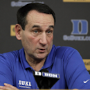Duke basketball coach Mike Krzyzewski reacts while speaking to members of the media during a press conference in Durham, N.C., Thursday, Sept. 18, 2014. (AP Photo/Gerry Broome)