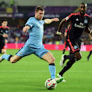 Manchester City's midfielder James Milner, left, shoots the ball under pressure of Hamburg defender Johan Djourou during a friendly match in Al Ain, United Arab Emirates, Wednesday, Jan. 21, 2015