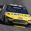 NASCAR driver Marcos Ambrose (9) drives during a practice for the NASCAR Sprint Cup Series auto race at Chicagoland Speedway in Joliet, Ill., Saturday, Sept. 13, 2014. (AP Photo/Paul J. Bergstrom)