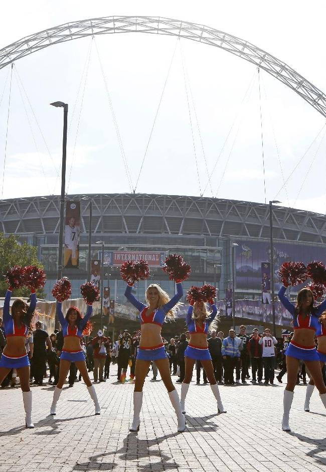 The NFL Allstars cheerleaders perform ahead of the NFL game between the Pittsburgh Steelers and Minnesota Vikings  at Wembley Stadium, London, Sunday, Sept. 29, 2013