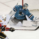 San Jose Sharks goalie Antti Niemi, of Finland, deflects a shot by Calgary Flames left wing Brandon Bollig (25) during the second period of an NHL hockey game Wednesday, Nov. 26, 2014, in San Jose, Calif. (AP Photo/Marcio Jose Sanchez)