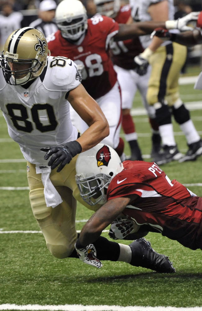 New Orleans Saints tight end Jimmy Graham (80) reaches over the goal line on a touchdown reception over Arizona Cardinals cornerback Patrick Peterson (21) in the second half of an NFL football game in New Orleans, Sunday, Sept. 22, 2013