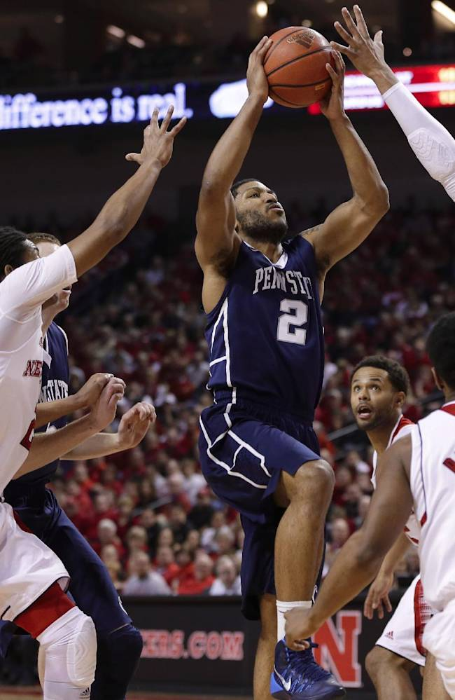 Penn State's D.J. Newbill (2) goes for a layup against the defense of Nebraska players from left: Shavon Shields (31), David Rivers, Benny Parker (3) and Walter Pitchford (35), in the first half of an NCAA college basketball game in Lincoln, Neb., Thursday, Feb. 20, 2014