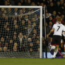 Fulham's Kieran Richardson, right, scores against Liverpool during their English Premier League soccer match at Craven Cottage, London, Wednesday, Feb. 12, 2014