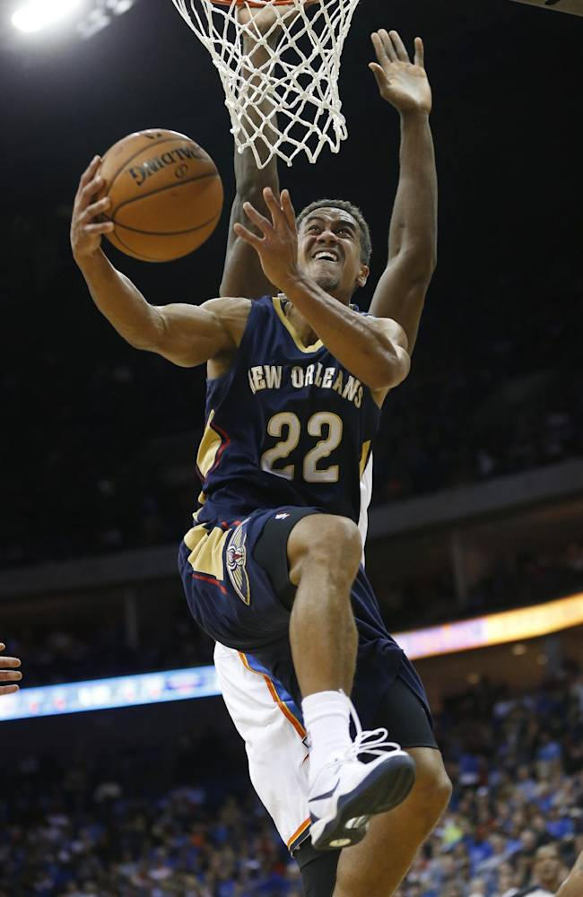 New Orleans Pelicans guard Brian Roberts (22) goes up for a shot in front of Oklhaoma City Thunder forward Serge Ibaka in the second quarter of an NBA basketball preseason game in Tulsa, Okla., Thursday, Oct. 17, 2013
