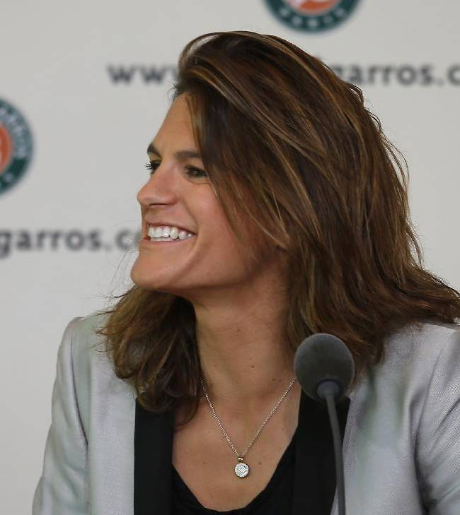 French tennis great Amelie Mauresmo smiles during a press conference at the Roland Garros stadium, in Paris, France, Sunday, June 8, 2014. Britain's Andy Murray has appointed  Mauresmo as his coach Sunday. The Wimbledon champion, who lost to Rafael Nadal in the French Open semifinals on Friday, will work with Maursemo at least through the grass-court season