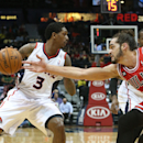 Chicago Bulls center Joakim Noah (13) knocks the ball away from Atlanta Hawks guard Lou Williams (3) in the first half of an NBA basketball game Wednesday, April 2, 2014, in Atlanta The Associated Press