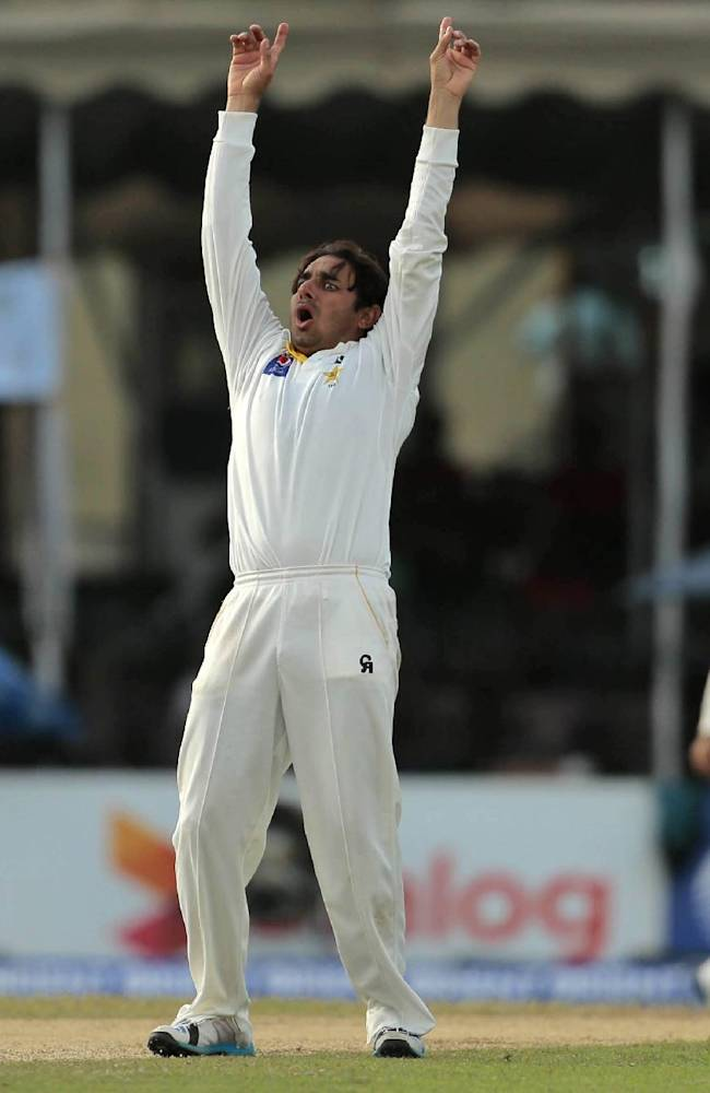 Pakistani bowler Saeed Ajmal appeals unsuccessfully for the dismissal of Sri Lanka's Niroshan Dickwella during the first day of the second test cricket match between Sri Lanka and Pakistan in Colombo, Sri Lanka, Thursday, August 14, 2014