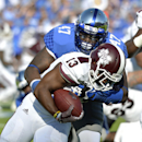 Kentucky's Jabari Johnson, rear, tackles Mississippi State's Josh Robinson during the first quarter of an NCAA college football game at Commonwealth Stadium in Lexington, Ky., Saturday, Oct. 25, 2014. (AP Photo/Timothy D. Easley)