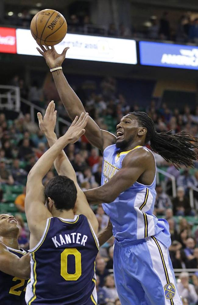 Denver Nuggets' Kenneth Faried, right, lays the ball up as Utah Jazz's Richard Jefferson, left, and teammate Enes Kanter (0), of Turkey, defend in the first quarter during an NBA basketball game Monday, Nov. 11, 2013, in Salt Lake City