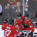 Chicago Blackhawks right wing Marian Hossa (81) celebrates his goal with teammates Johnny Oduya (27) and Brandon Saad, during the second period of an NHL hockey game Tuesday, Dec. 16, 2014, in Chicago The Associated Press