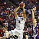 UCLA guard Kyle Anderson (5) goes in for a score during the first half of a third-round game in the NCAA college basketball tournament, Sunday, March 23, 2014, in San Diego. (AP Photo/Denis Poroy)