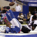 Indianapolis Colts wide receiver Reggie Wayne, left, loses the ball as he's hit by Baltimore Ravens cornerback Jimmy Smith in the end zone during the second half of an NFL football game in Indianapolis, Sunday, Oct. 5, 2014 The Associated Press