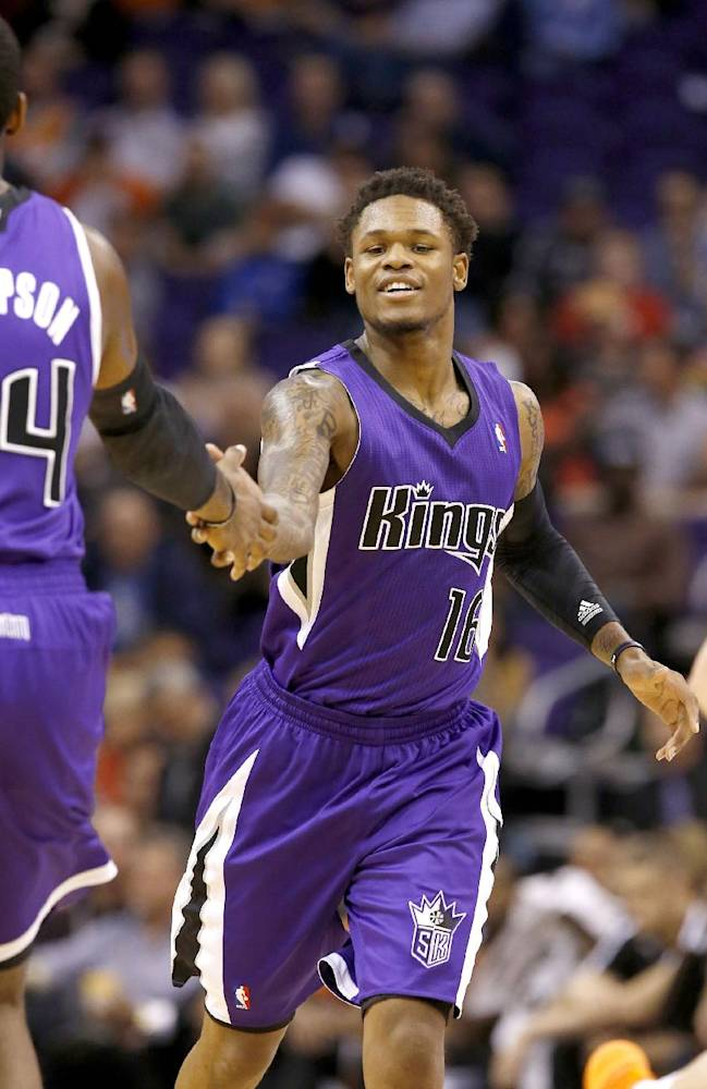 Sacramento Kings' Ben McLemore (16) shakes hands with teammate Jason Thompson during the second half of an NBA basketball game against the Phoenix Suns, Wednesday, Nov. 20, 2013, in Phoenix. The Kings won 113-106