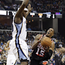 Miami Heat guard Mario Chalmers (15) drives against Memphis Grizzlies forward Zach Randolph, left, in the first half of an NBA basketball game Wednesday, April 9, 2014, in Memphis, Tenn The Associated Press
