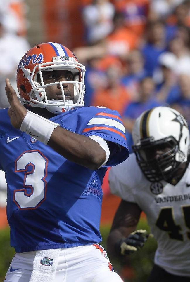 Florida quarterback Tyler Murphy (3) looks for a receiver during the first half of an NCAA college football game against Vanderbilt, Saturday, Nov. 9, 2013, in Gainesville, Fla