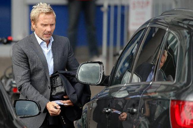Former Hamburg soccer coach, Thorsten Fink leaves the club's headquarter in Hamburg, Tuesday Sept. 17, 2013.  Hamburger SV has fired Thorsten Fink as coach following a disappointing start to the Bundesliga. Hamburg chairman Carl Jarchow announced the club's decision on Tuesday, saying the 45-year-old Fink was informed late Monday