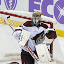 Arizona Coyotes goalie Mike Smith deflects a Minnesota Wild shot during the third period of an NHL hockey game, Thursday, Oct. 23, 2014, in St. Paul, Minn. The Wild won 2-0 The Associated Press